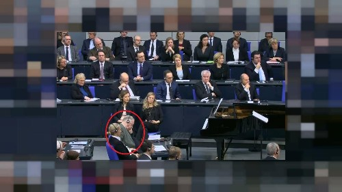 German right-wing MP closes eyes and slumps during Holocaust speech