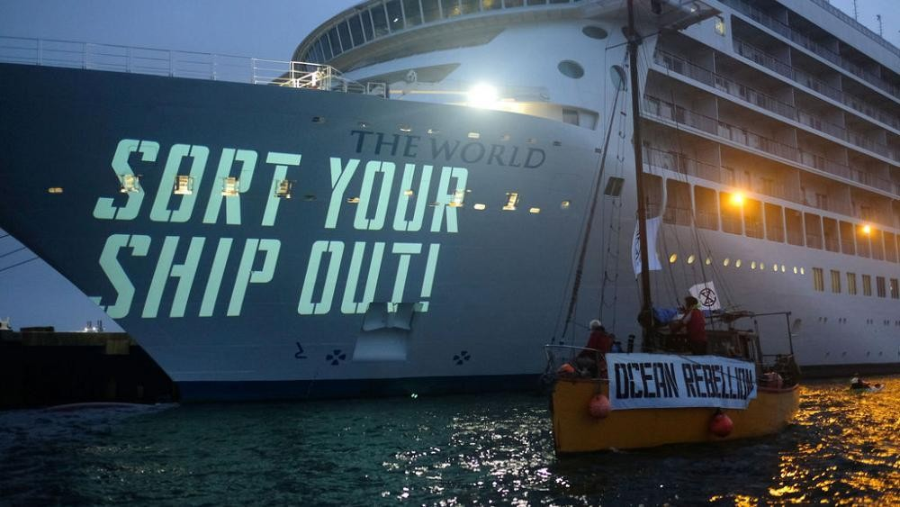 'Sort your ship out!': Extinction Rebellion take to the seas to protest cruise ship pollution