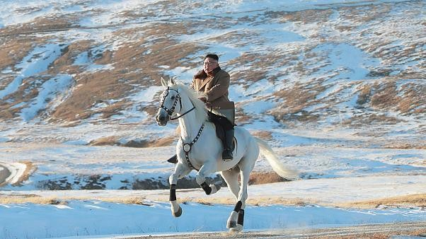 Kim rides horse on sacred peak, vows to fight U.S. sanctions