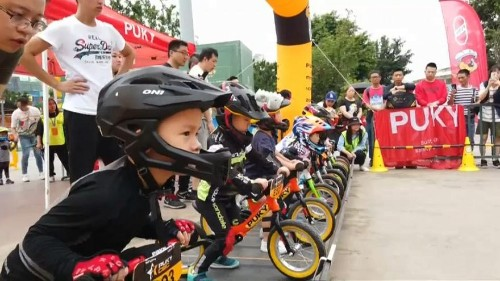Young riders sprint on balance bike course in southwest China