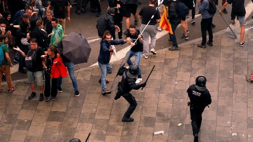 Protesters and police in fierce battles at Barcelona airport