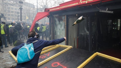 Rioters set fire to a bank and ransack luxury shops in central Paris