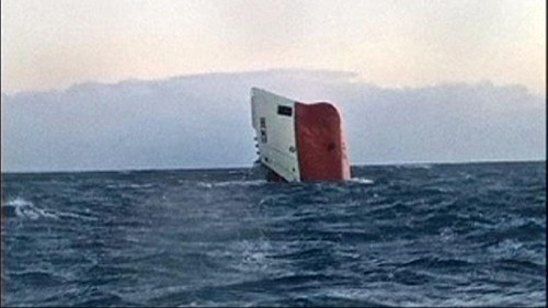 Eight crew missing after cargo ship overturns off Scotland