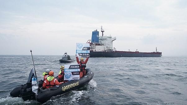 Watch: Polish officers smash windows of Greenpeace ship with sledgehammers