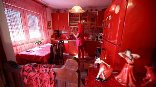 Lady in red: Bosnian has kept to the same colour all her adult life