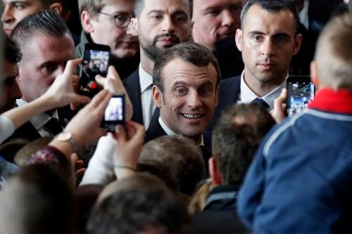 French farmers warm to Macron as he calls on EU to keep budget big