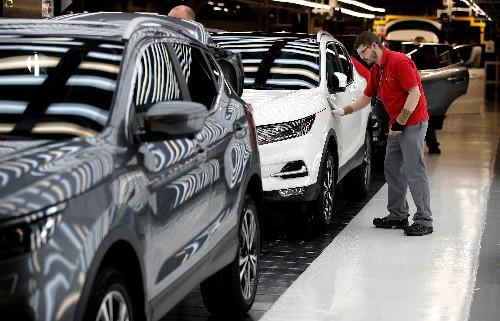 Nissan shares skid after profit plunge, outlook cut