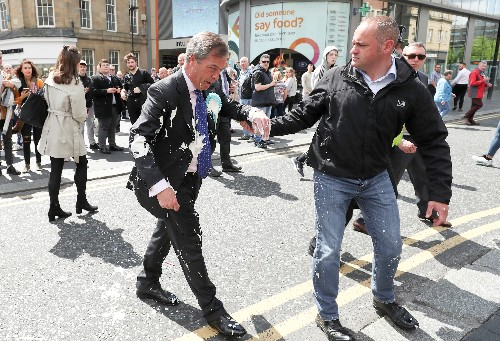 All shook up: Brexit Party's Nigel Farage doused with milkshake on campaign