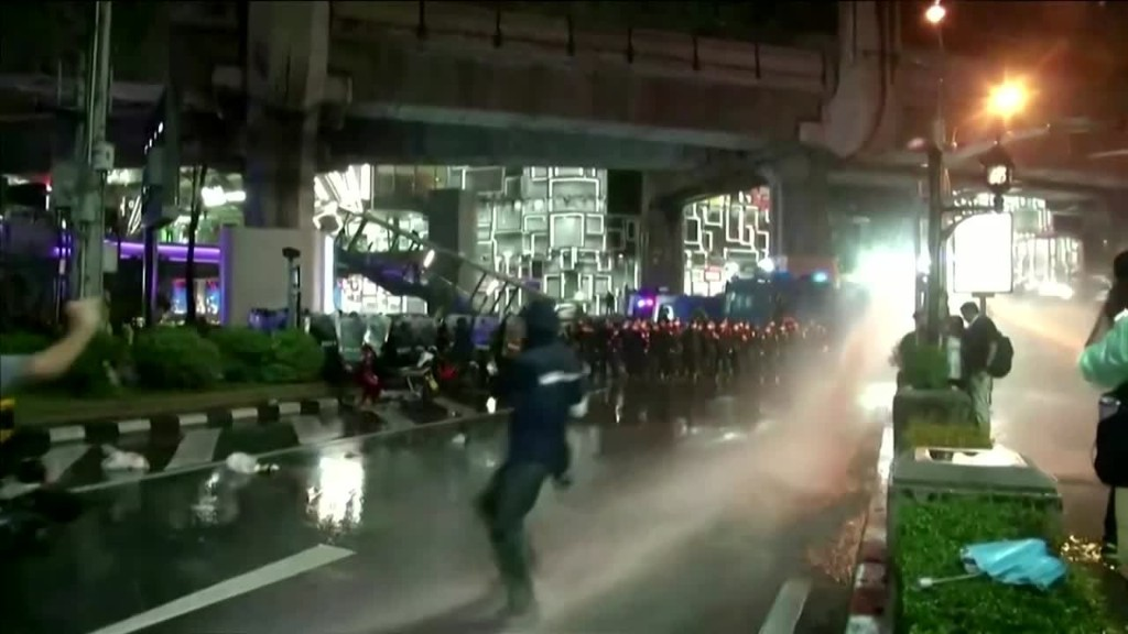 Thai police turn water cannon on defiant streets