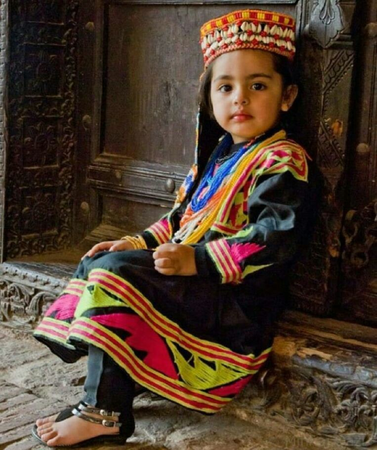 Traditional dress of northern area of Pakistan .