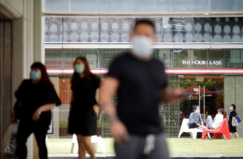 Singapore closes workplaces, schools as coronavirus cases jump