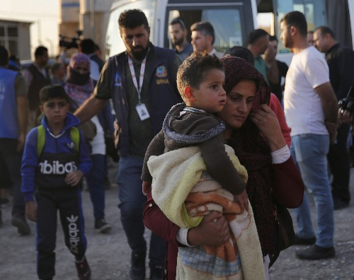 Aid groups scramble to reach Syrians as battle lines shift