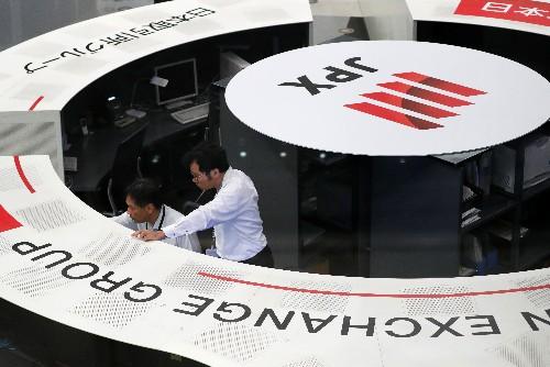 Asian shares inch higher, euro teeters on weak economic outlook