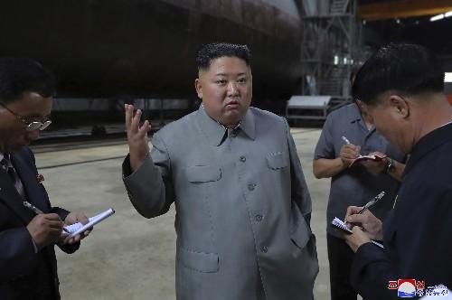 Kim inspects new submarine, wants NKorean military bolstered