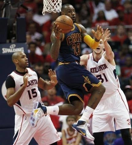 Smith, James lead Cavs past Hawks 97-89 in Game 1