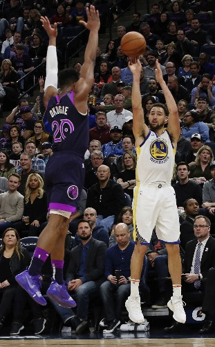 Curry leads Warriors past Wolves 117-107, into 1st in West