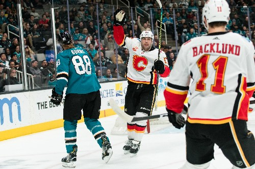 Flames flaunt renewed scoring touch, top Sharks
