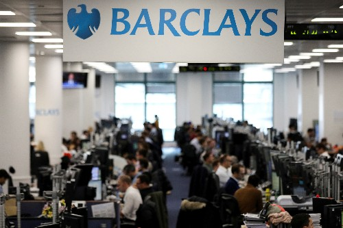 Britain's Barclays hit by struggling investment bank, flags cost cuts