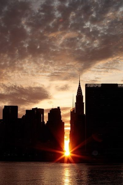 Manhattanhenge: Thousands gather to see setting sun aligning with New York City's east-west streets