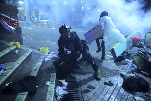 Hong Kong officer hit by arrow; police fire water cannons