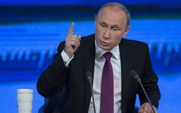 Defiant Vladimir Putin digs in for two-year slump, dismisses talk of palace coup