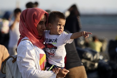 The Latest: 635 migrants from Lesbos reach Greek mainland