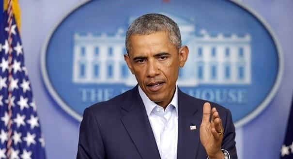 Obama shuns emotional rescue on race