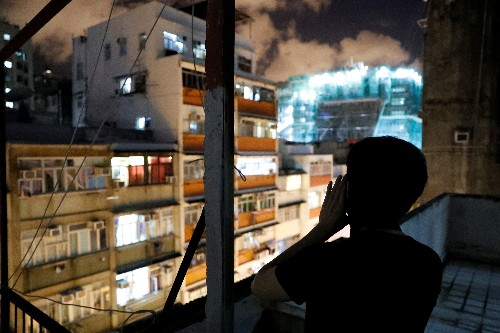 Hong Kong neighbourhoods echo with late night cries for freedom