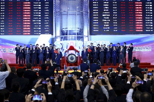 Asian shares lower, Shanghai STAR tech board shares surge
