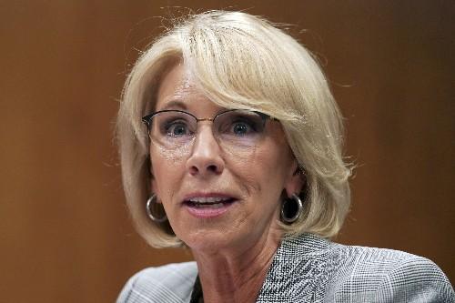 Facing lawsuit, DeVos erases student loans for 1,500
