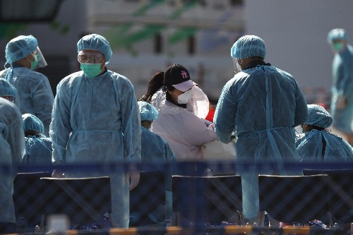 Japan government faces questions over coronavirus, Tokyo cancels events