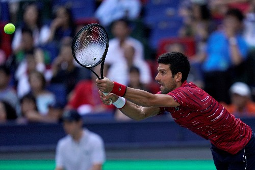 Djokovic, Federer progress to Shanghai quarters
