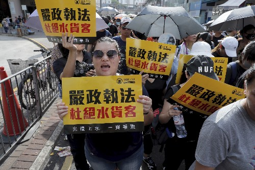 Clashes erupt as Hong Kong protest targets Chinese traders