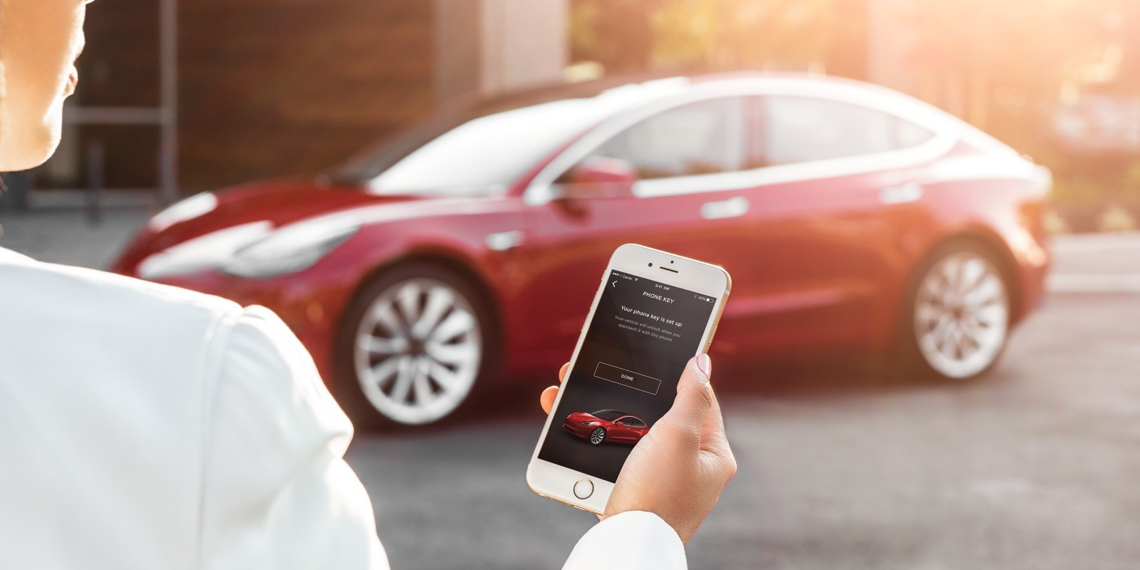 Tesla releases new Model 3 pictures to show its key card and iPhone-based unlocking system