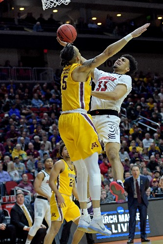 Minnesota stuns Louisville for first tourney win since '13