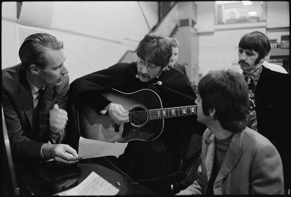 """""""Picture yourself in a boat on a river"""" John runs through Lucy In The Sky with Diamonds at Abbey Road Studios. Photo by Frank Herrman, 1967."""