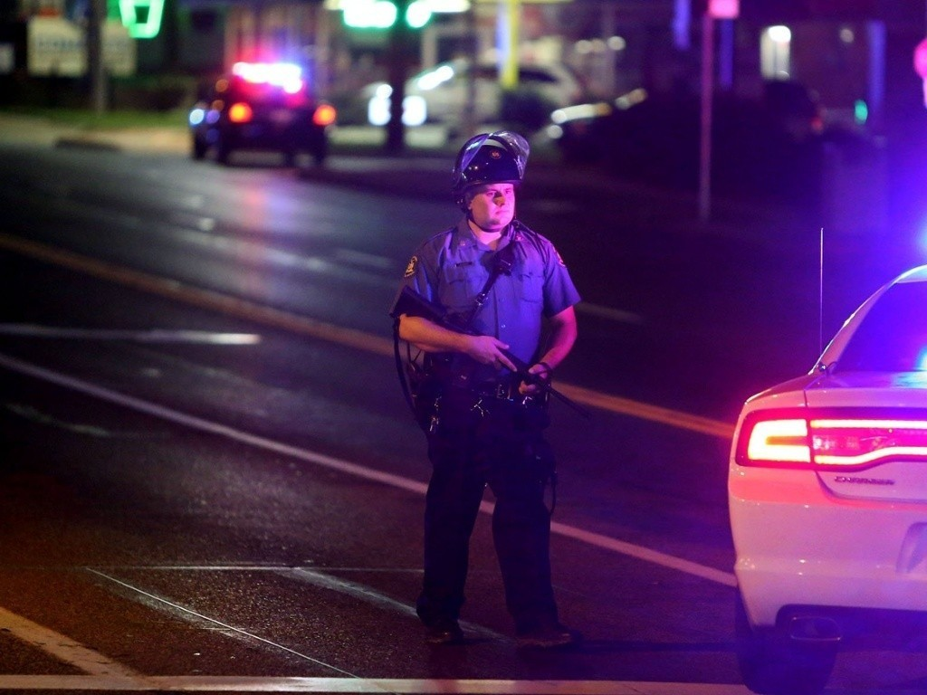 Two suspects sought after shooting of Ferguson police officer