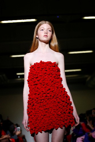 Gucci puts on masquerade catwalk as Milan Fashion Week opens