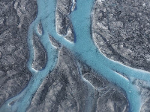 Walloped by heat wave, Greenland sees massive ice melt