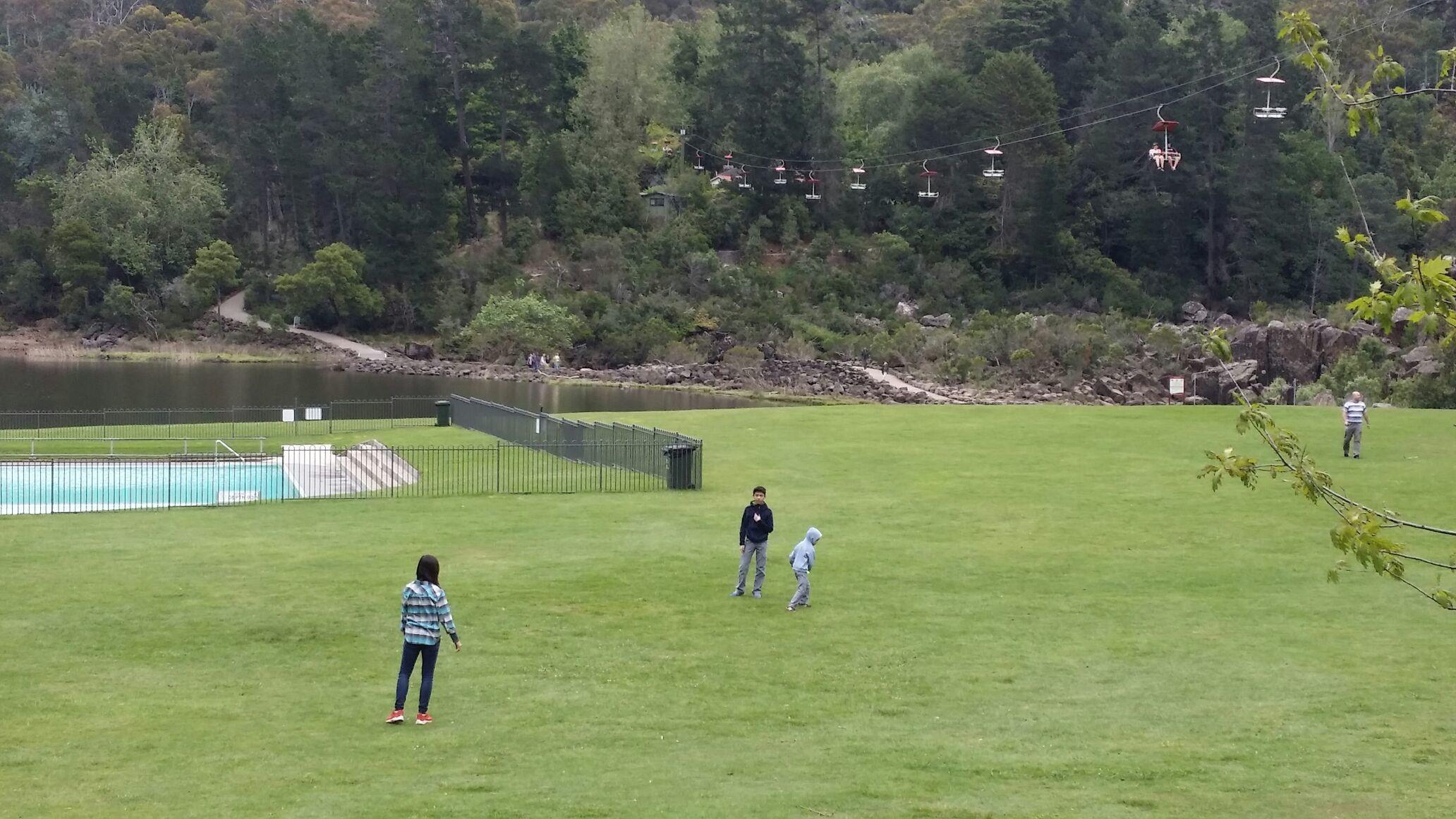Family playing Frisbee at Cataract's Gouge, Launceston, Tasmania.