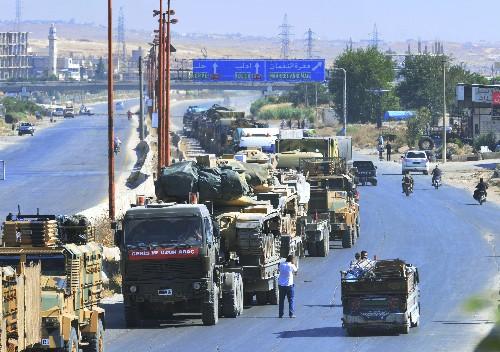 Militants leave key rebel town as Syrian troops push in