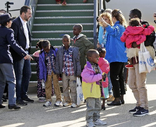 The Latest: Italy's anti-migrant minister greets refugees
