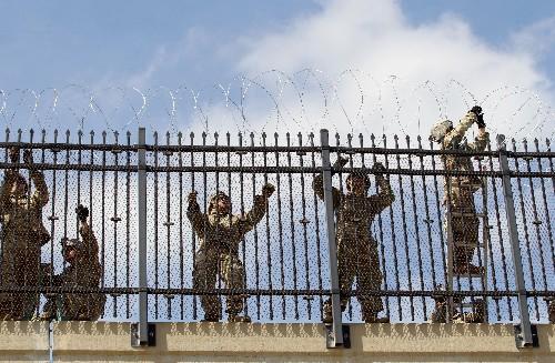 Trump limits asylum from Mexico border, caravans head north