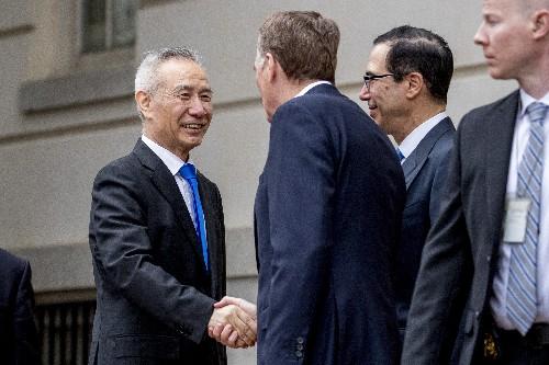 China demands US lift tech curbs, will 'safeguard' interests