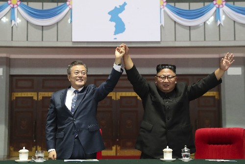 Kim, Moon head to North Korea's sacred volcano on final day