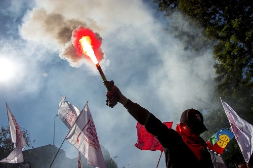 May Day Protests and Parades: Pictures