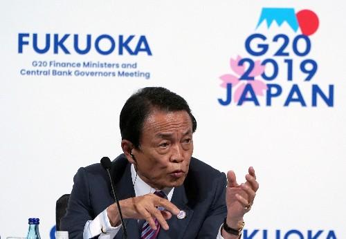Japan finance minister warns against yen gains, seeks FX stability