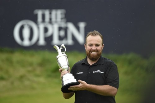 Lowry learns from bitter past to savour Open glory