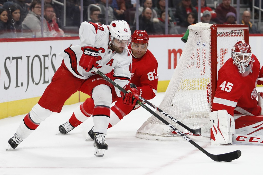 Aho scores twice as Hurricanes wallop Wings