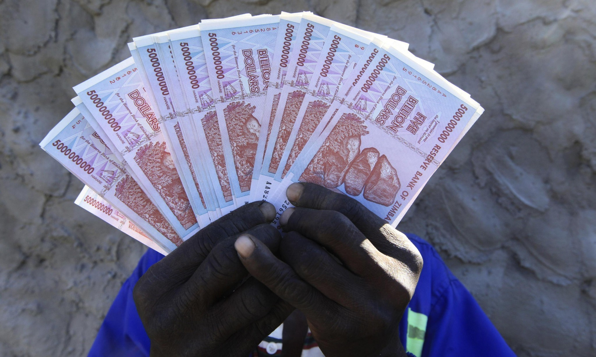 Zimbabwe to print local 'US dollar' to ease severe cash crunch